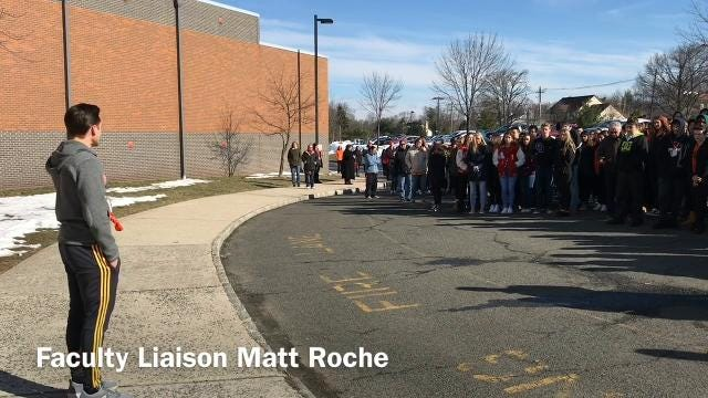 All of the 850 students, faculty, staff and administration at Bishop Ahr High School in Edison participated in a walkout and prayer service in memorial to the 17 killed one month ago in Parkland, Fla., and in protest of school gun violence.