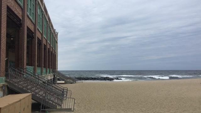 Ahead of the snowstorm, watch the waves crash on the Asbury Park beach.