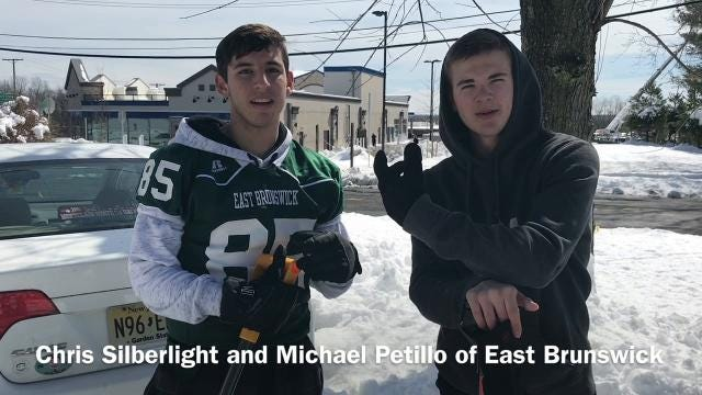 East Brunswick High School seniors Chris Silberlight and Michael Petillo expect to make about $150 each shoveling a dozen houses in their neighborhood along Hillsdale Road.