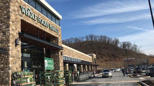 "More than 250 gathered for the grand ""bread breaking"" of Whole Foods Market at the new Chimney Rock Crossing shopping center in Bridgewater on March 23."