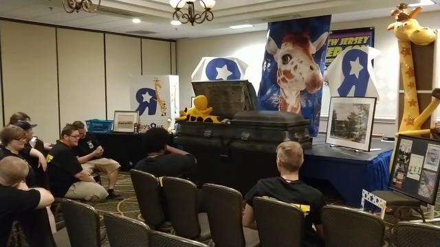 """New Jersey Gamer Con held an impromptu funeral viewing for Toys """"R"""" Us mascot, Geoffrey the Giraffe,  on July 8 to commemorate the official closing of the company's corporate headquarters on Friday."""