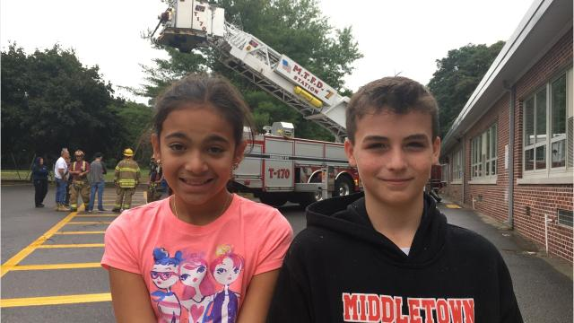 Braden Tolas and his stepsister Davela Dente, both 11, have a story to tell after getting stuck in a tree near their Middletown home.