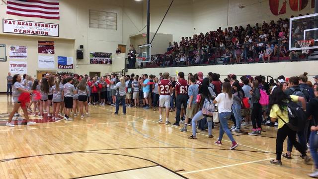 Students cheer on the football team at the first pep rally of the season.