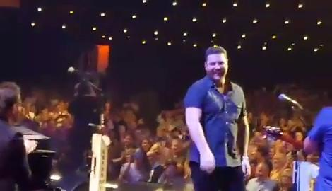Country music star Chris Young got surprise on stage at the Grand Ole Opry, when Vince Gill invited him to become a member, Aug. 29, 2018.
