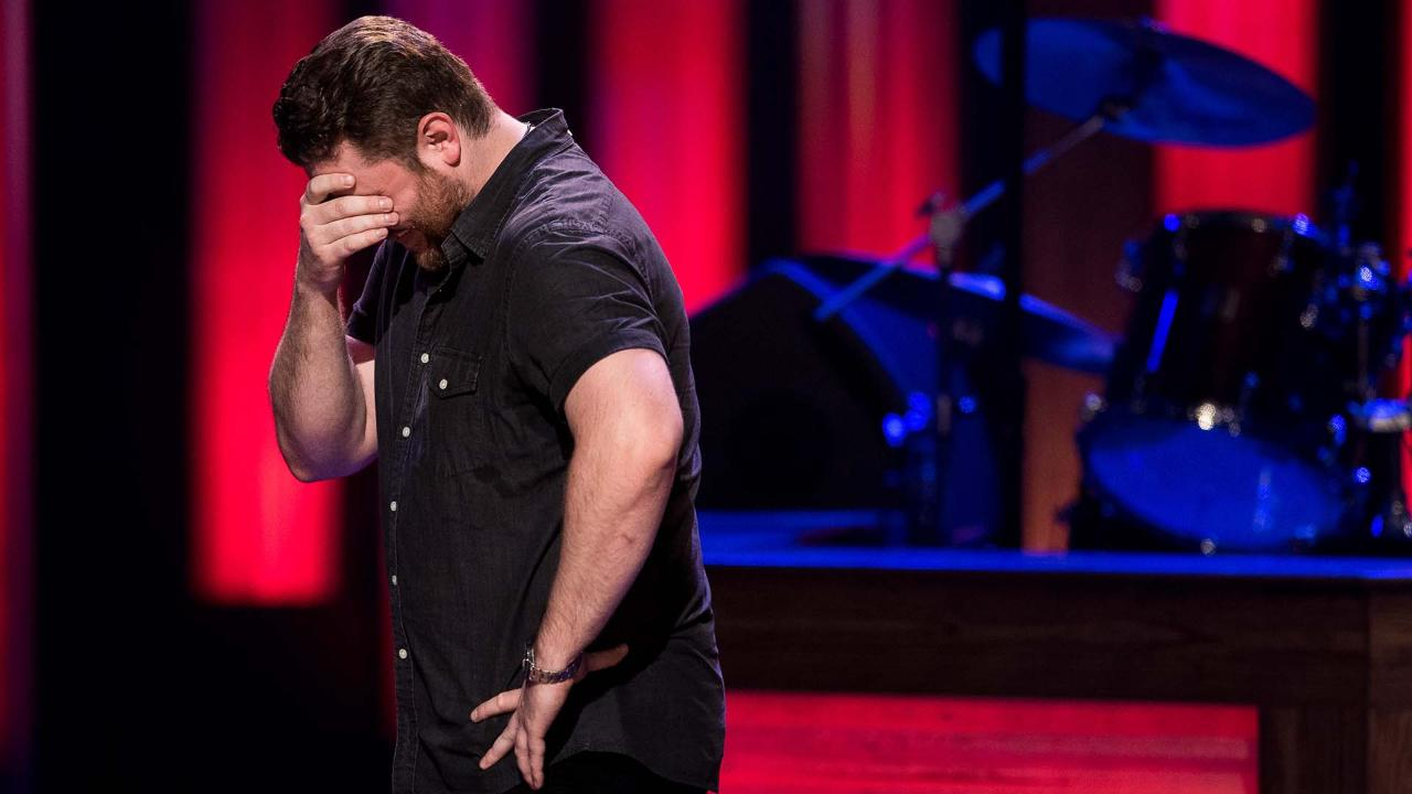 Chris Young reacts after he was invited to join the Opry by Vince Gill at The Grand Ole Opry House in Nashville, Tenn., Tuesday, Aug. 29, 2017.