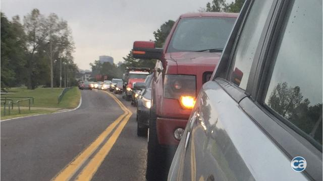 Traffic snarled on Mud Island when residential enclave's primary access is shut off by reconstruction of railroad/trolley crossing at east end of A.W. Willis Bridge.