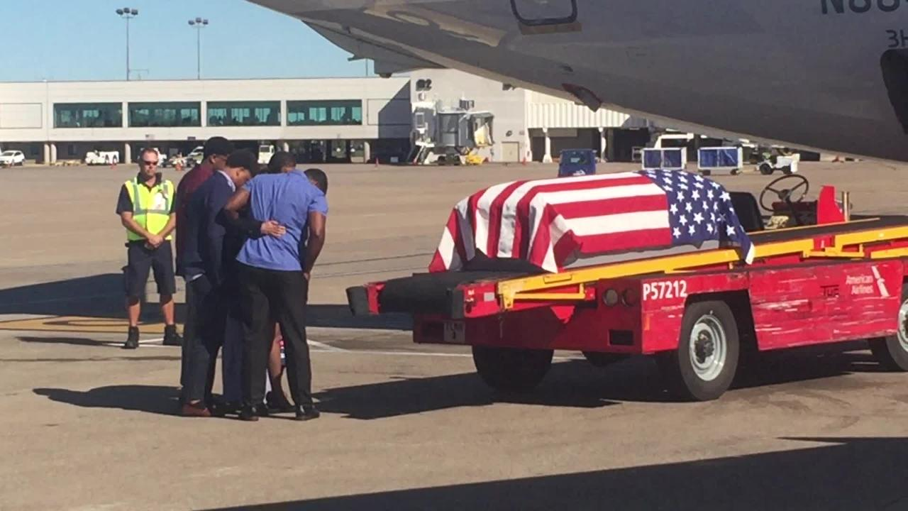 Family members of Staff Sgt. Michael Nelson, 30, greet his casket as it is unloaded off an airplane Tuesday at Nashville International Airport.