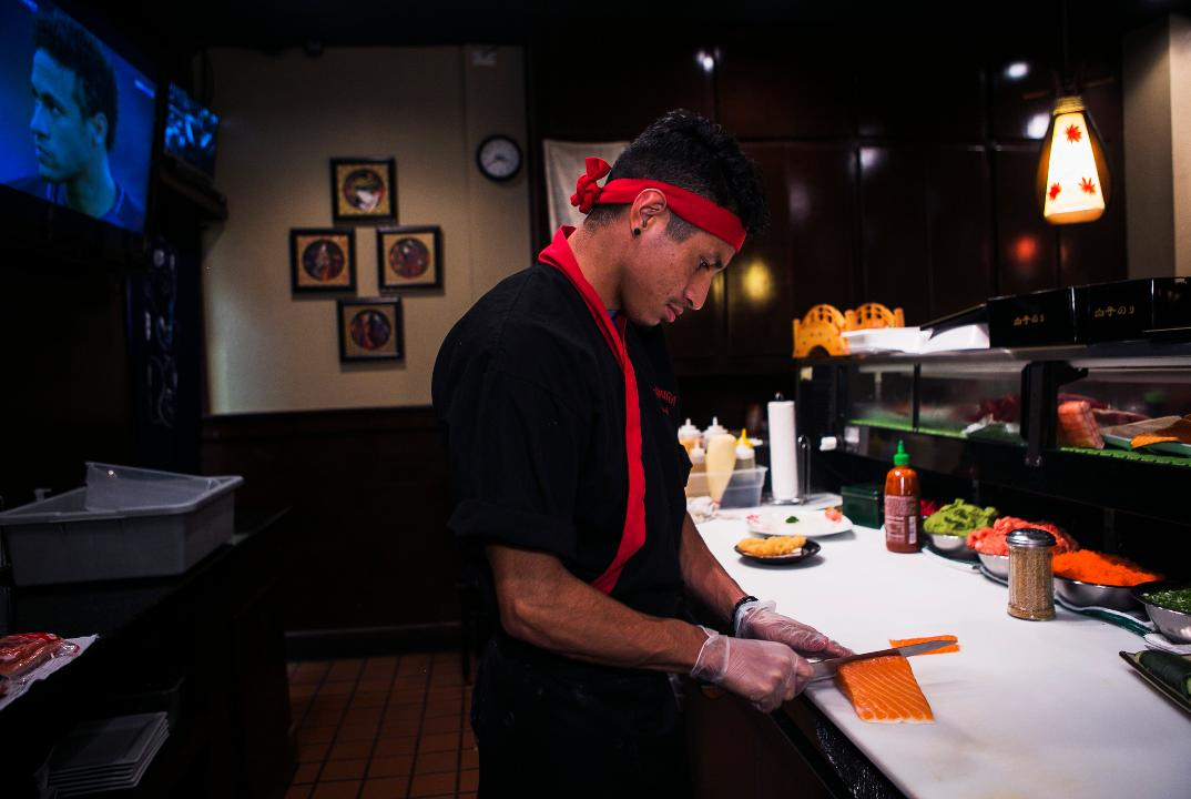 David Flores makes New Orleans and Sexy Lady sushi rolls at Sakura Japanese Restaurant at 4840 Poplar Ave.