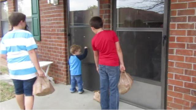 Fairview homeschoolers deliver food to senior residents as a community service project.