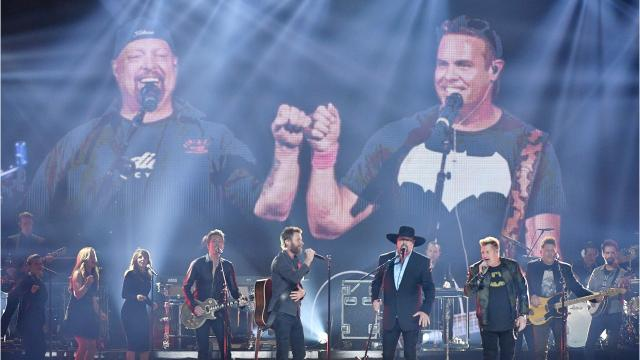 """Rascal Flatts, Dierks Bentley and Eddie Montgomery honored Troy Gentry by playing """"My Town"""" at the 2017 CMA Awards and country fans reacted on Twitter. Troy Gentry died in a helicopter accident in September."""