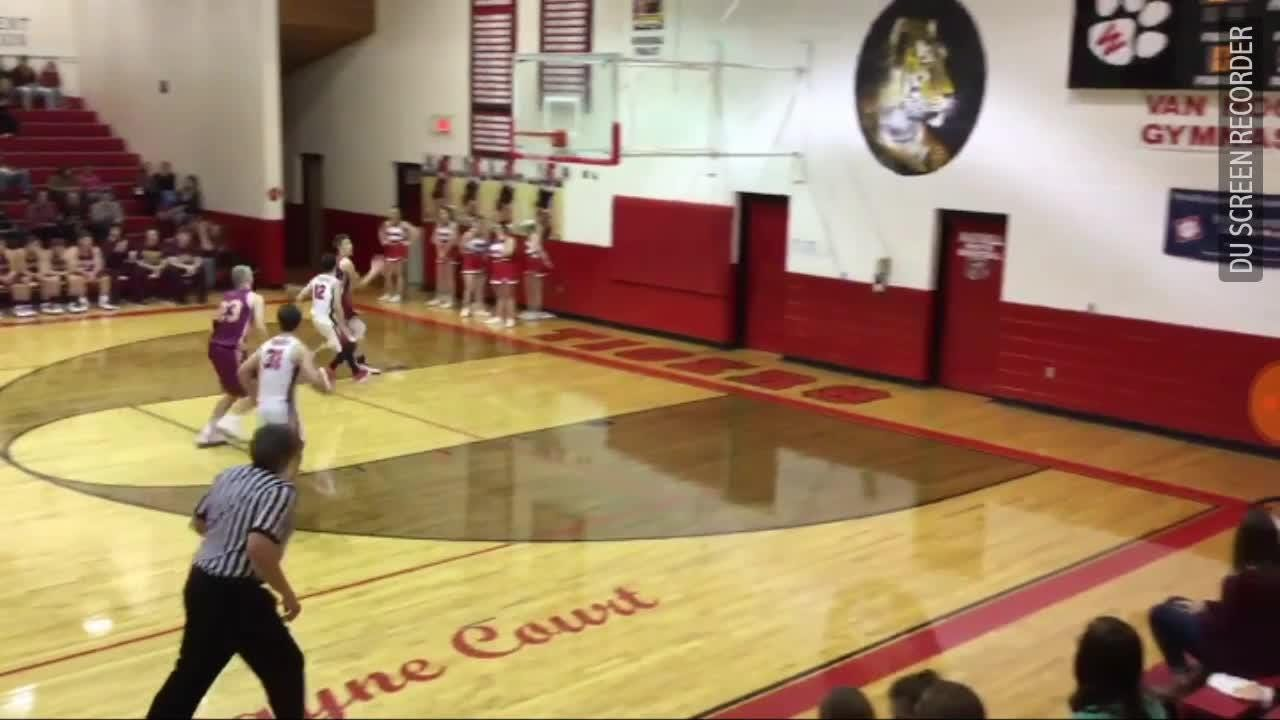 Caden Mills dunks off backboard