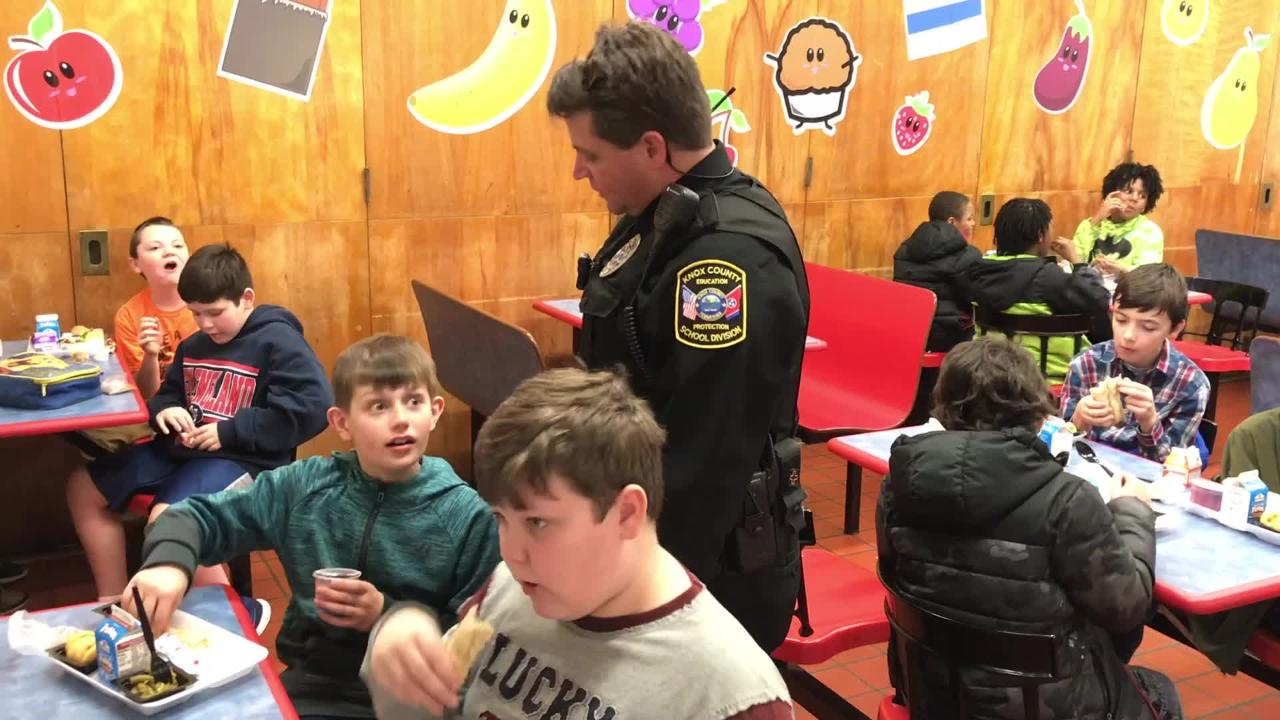 SRO Doug Grimm spends lunchtime with South Knoxville Elementary students