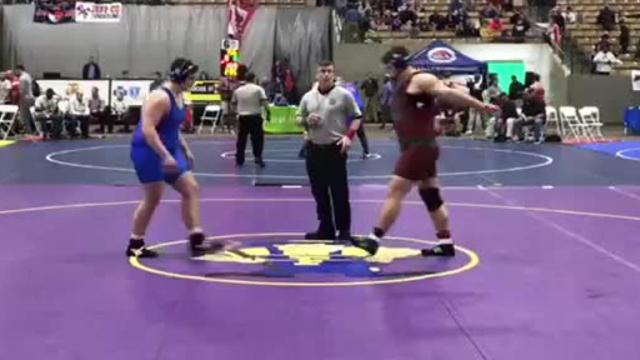 Wilson Central's Michael Kramer reaches the final at 285 pounds.