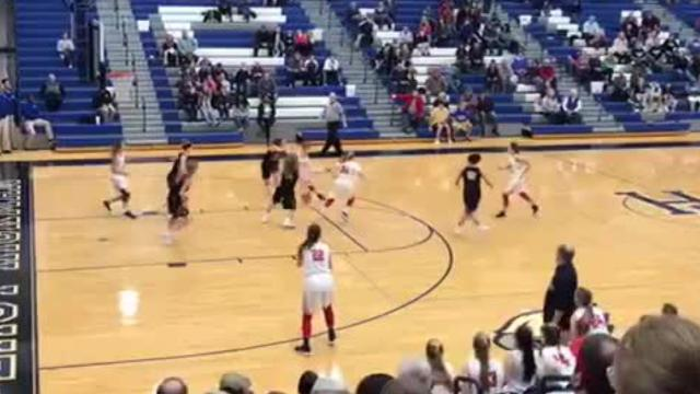 Hohl connected on a 3-pointer as time expired to secure the Lady Red Hawks sixth straight 11-AA district title on Saturday.