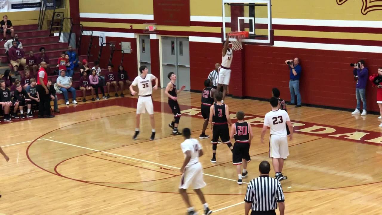 Riverdale's Elijah Cobb throws down the alley oop against Coffee County in the Region 4-AAA quarterfinals.