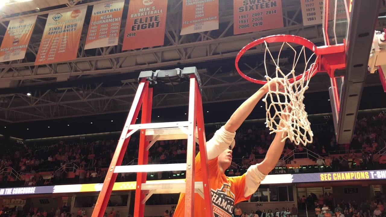 Tennessee players cut down the net after winning the SEC championship