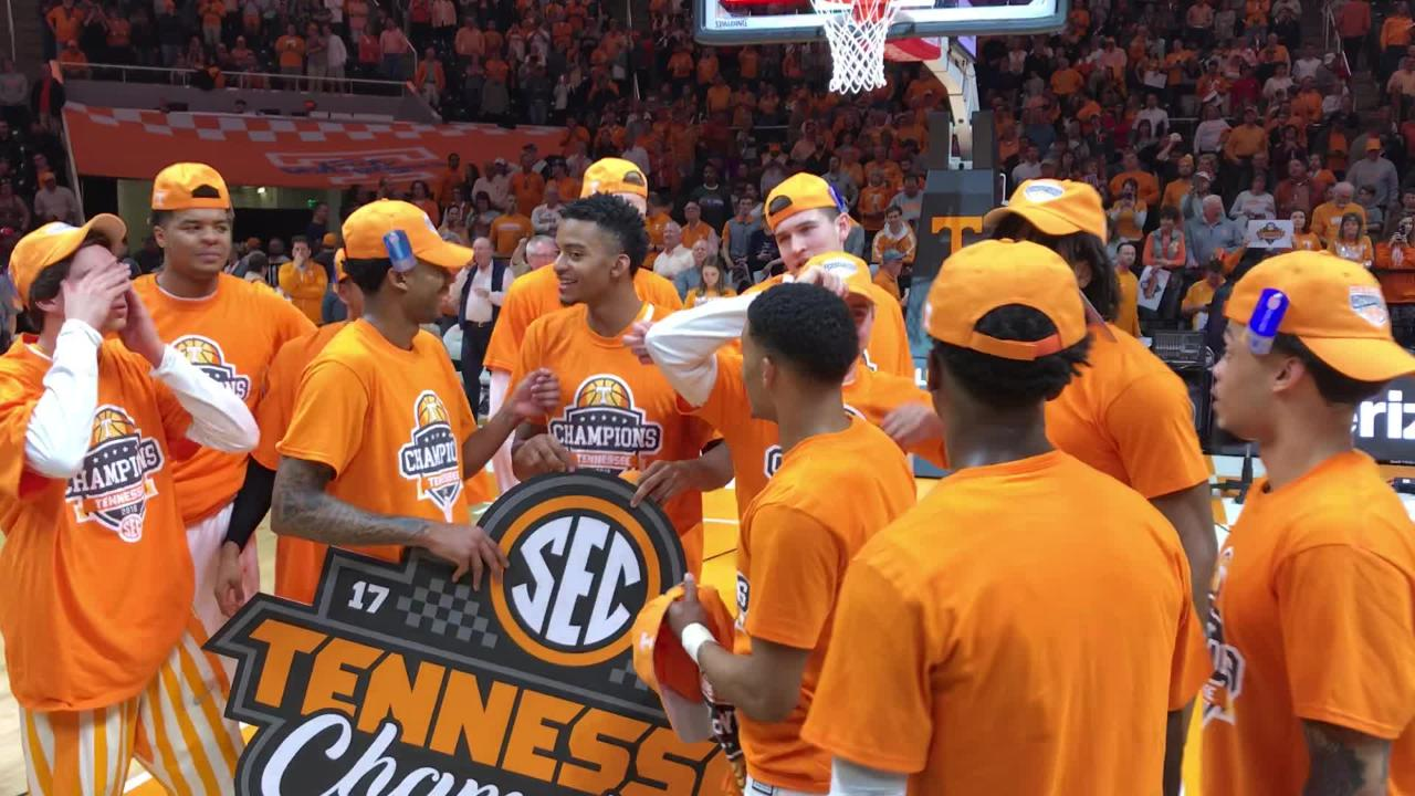 Tennessee players celebrate after winning a share of the SEC title