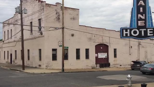 A four-story, 68-unit apartment building is proposed to replace a long-vacant building next to the Lorraine Motel.