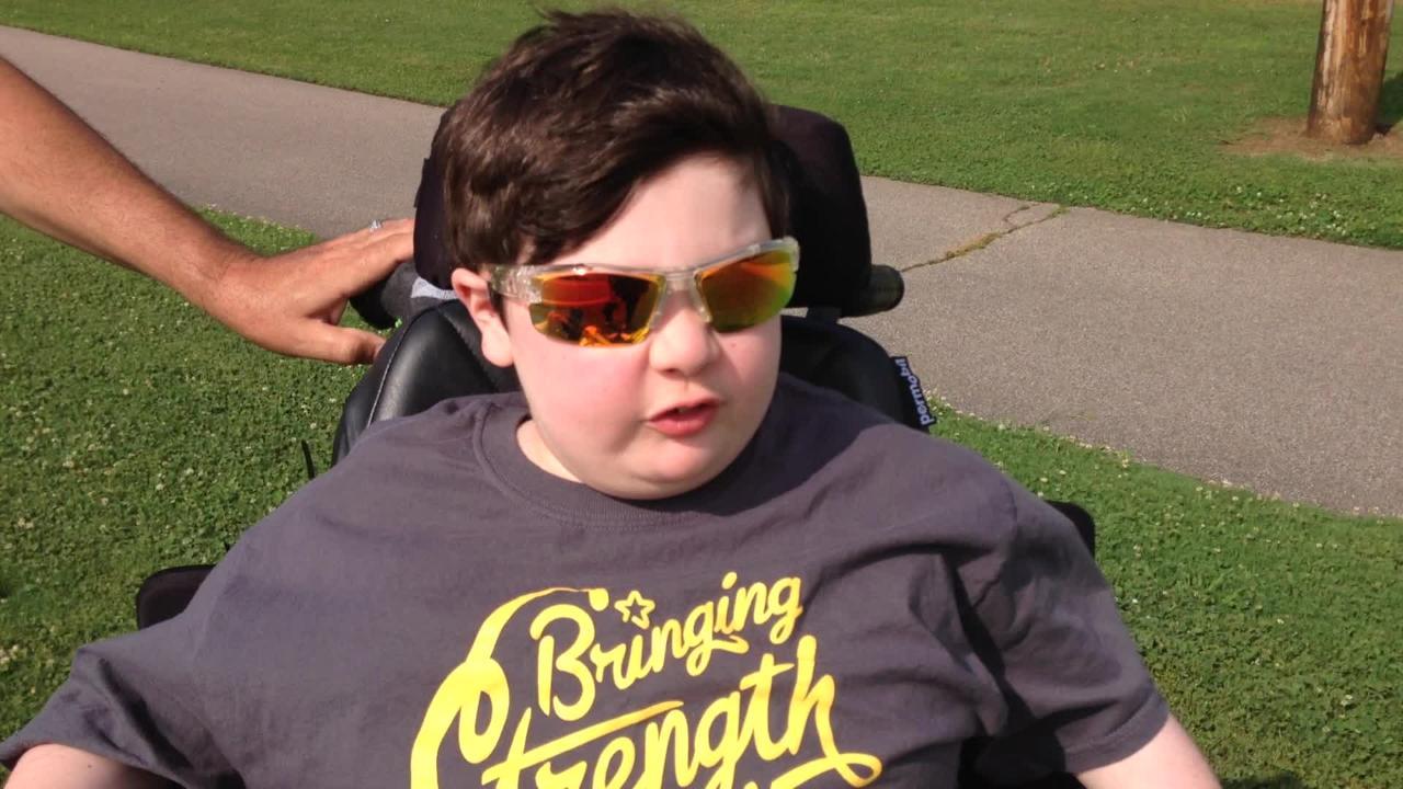 Dalton Al-Chokhachi, 13,  helps Memphis firefighters raise money for the Muscular Dystrophy Association.