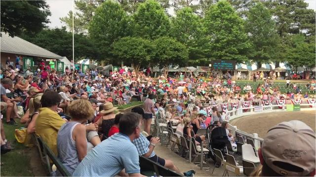 The Germantown Charity Horse Show paused to listen to the Belmont Stakes and celebrated together as Justify won the Triple Crown.