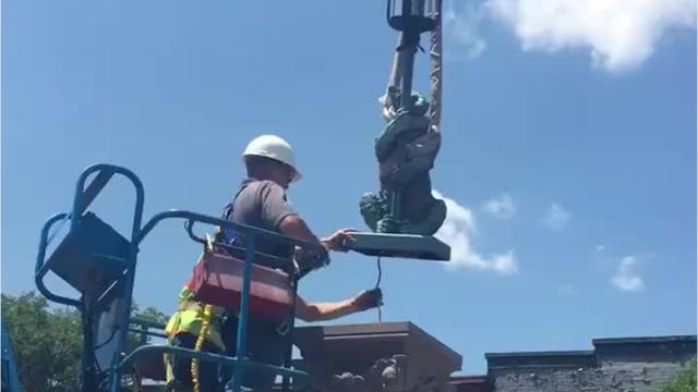 Workers reinstalled the iconic bear fountain in the heart of Geneseo. (June 28, 2017)