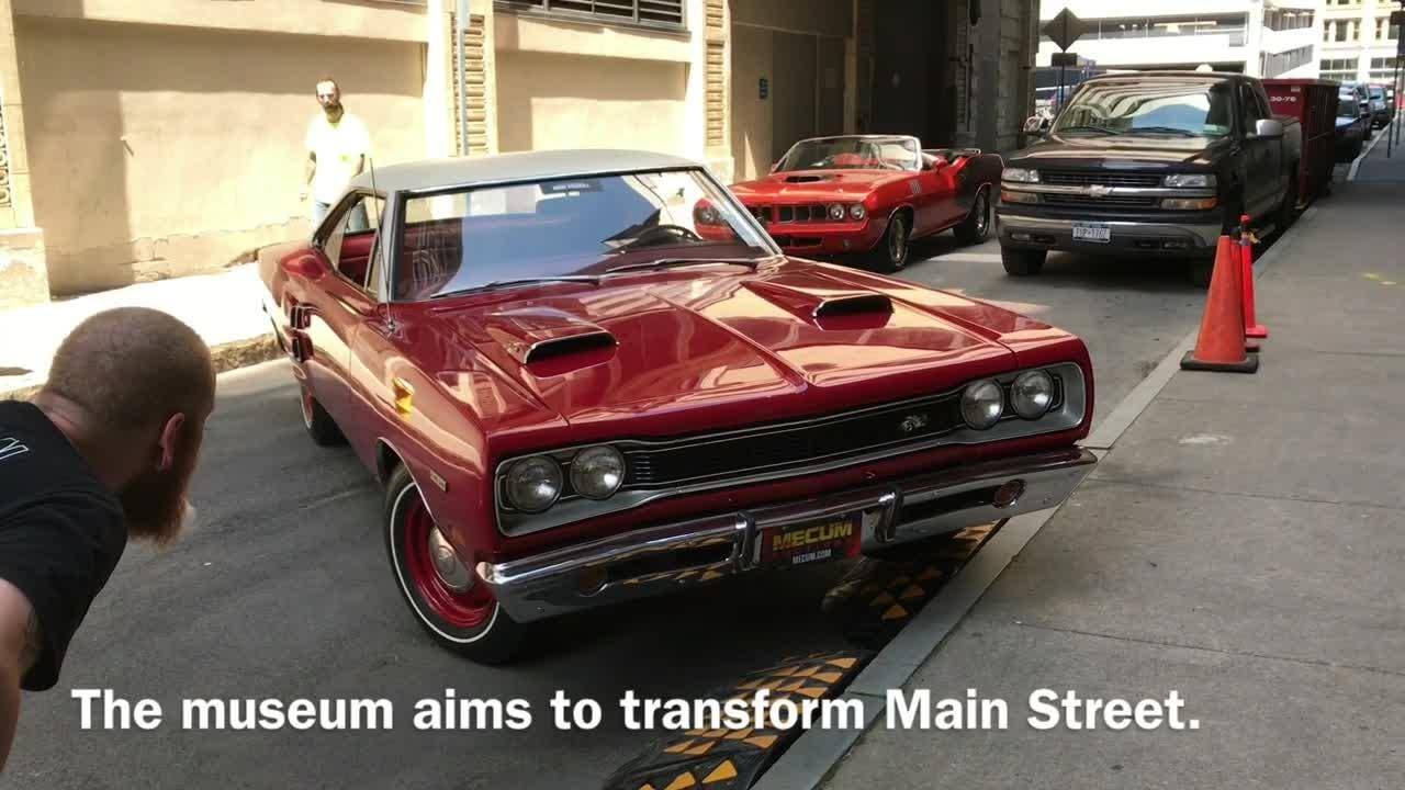 Shiny muscle cars made their way through downtown Wednesday on their way to a muscle car museum, Rochester Auto Museum, that will open on Main Street. (July 7, 2017)