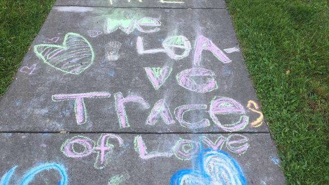 Chalk artists left their message on a stretch of sidewalk along Harry Allen Park, Honeoye Falls N.Y.  This after a flyer was distributed showing a local man who attended the Charlottesville march.