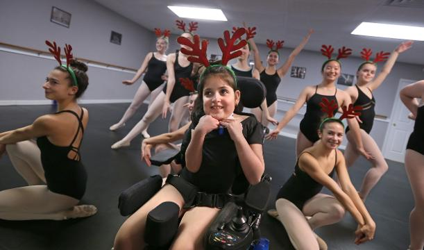 Giana Bisnett, who has spina bifida, will dance with Roc Dance studio troupe at an upcoming holiday show.
