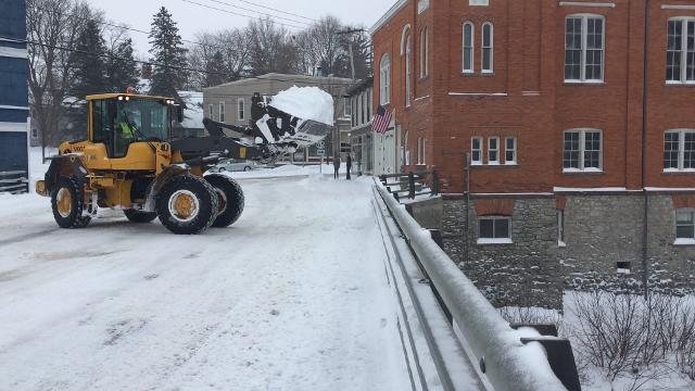 Honeoye Falls crews use a front loader to dump some of it in the creek. (Jan 13, 2017)
