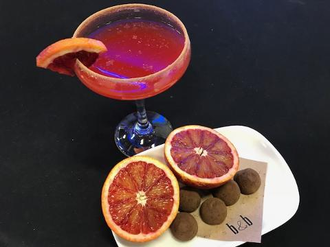 Emily Sharp, bar captain from Black & Blue Steak and Crab, prepares a Chocolate Blood Orange Coupe. (Feb. 6, 2018)
