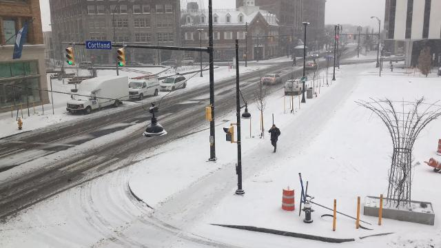 The sidewalk plow cleared the way several times as snowfall became heavy this morning in downtown Rochester.