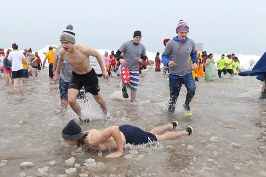 Hundreds of people made their way into a freezing Lake Ontario for the Polar Plunge to raise money for Special Olympics.