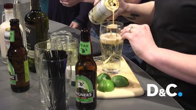 Danny and Jessica Barry, owners of Barry's Old School Irish in Webster, show Tracy Schuhmacher how to make two easy cocktails for St. Patrick's Day.