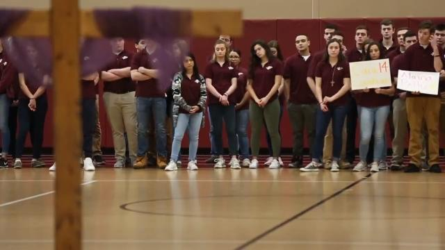 Students at Aquinas Institute in Rochester participated in Walkout Wednesday by holding a prayer service to remember the Parkland, Florida, shooting victims. (March 14, 2018)
