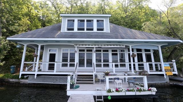 An 800-square-foot cottage directly on the water has two docks and sits on 7.64 acres.