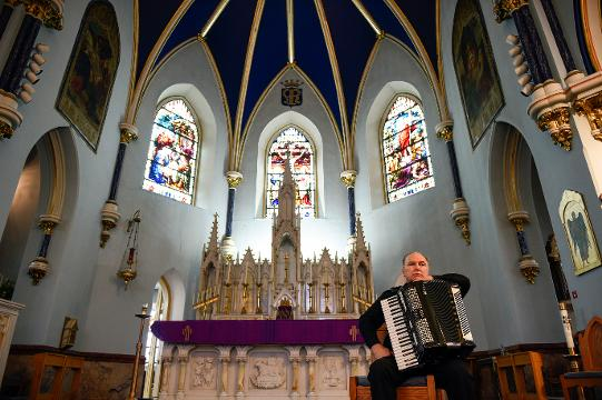 Monsignor William Hodge plays his accordion inside St. Mary's Church Friday, Feb. 23, 2018 in Gloucester City, N.J. Hodge is of Irish decent and has recorded multiple albums relating to his heritage and Catholicism.