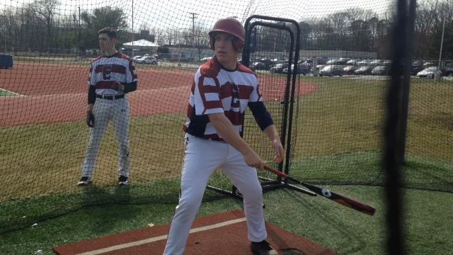 Eastern junior Dylan Stezzi is trying to debunk the myth of lefty catchers.