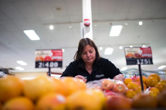 Produce manager Debbie Green culls apples for a food bank Wednesday, May 23, 2018 at ShopRite in Hammonton, N.J.