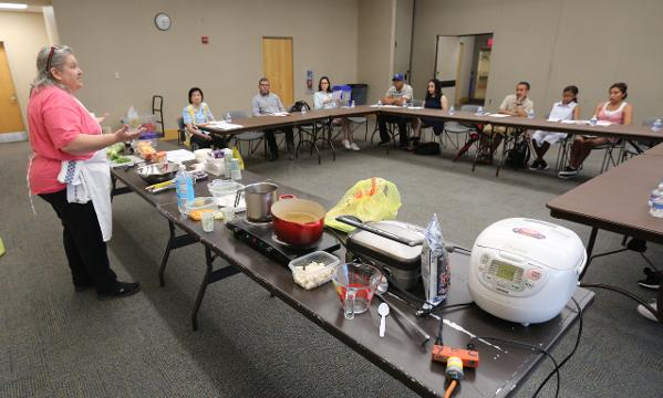 Chef Amalia Greco, leads a Japanese cooking class for a group of Spanish speaking attendees, during a program at the Riverfront Library at Larkin Center in Yonkers.