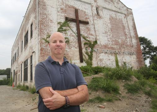 Jim Annicchiarico, project engineer with Cronin Engineering, talks about plans to convert the former school into a combination of art gallery space, studios and residences for artists Aug. 11, 2017.
