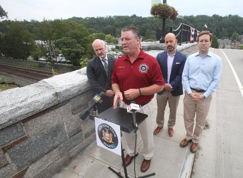 Officials speak about the proposed affordable housing project in downtown Chappaqua while standing on the Route 120 bridge in Chappaqua Aug. 15, 2017. Frank Becerra Jr./Lohud