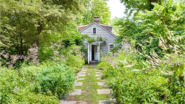 Artist, photographer, author and landscape designer Judy Tomkins lived in a magical house for 60 years.