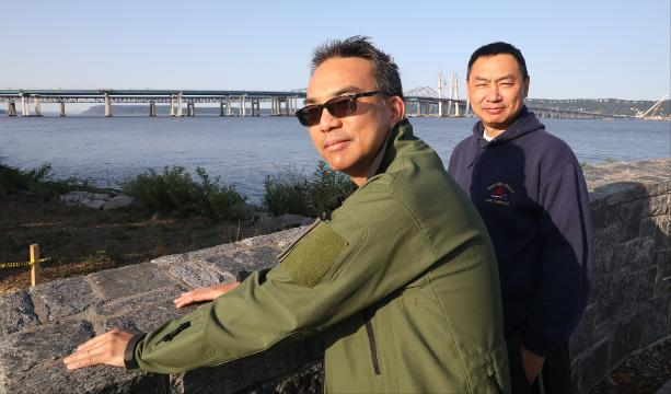 Viewers at Pierson Park in Tarrytown talk about the new Gov. Mario M..Cuomo bridge on opening day, Aug. 26, 2017.