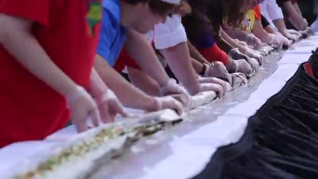 Purchase College students and staff break a record for the world's longest California roll overseen by Food Network's celebrity chef Jet Tila Oct. 11, 2017 in Purchase.
