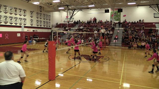 Nyack volleyball players and coaches rally around Nancy Owens during their game against Tappan Zee.