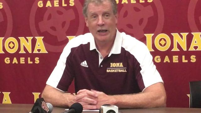 Iona basketball coach Tim Cluess on wet floor at Hynes Center