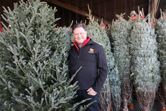 Stew Leonard Jr., president and CEO of Stew Leonard's, gives Christmas tree buying tips at the store in Yonkers.