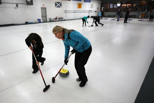 Curling fun and camaraderie with the members of the Ardsley Curling Club.