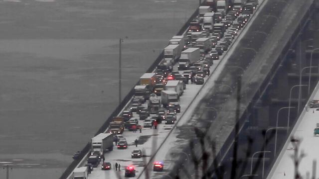 A view from Clausland Mountain looking down on the Mario Cuomo Bridge as traffic is stopped in both directions after multiple crashes on the snowy bridge Wednesday, Feb. 7, 2018.