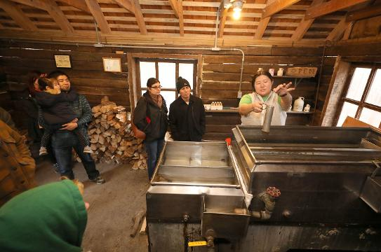"""Elissa Schilmeister, the environmental educator and volunteer coordinator at Teatown Lake Reservation in Ossining, talks about making maple syrup during the """"Sugaring Sundays"""" program."""